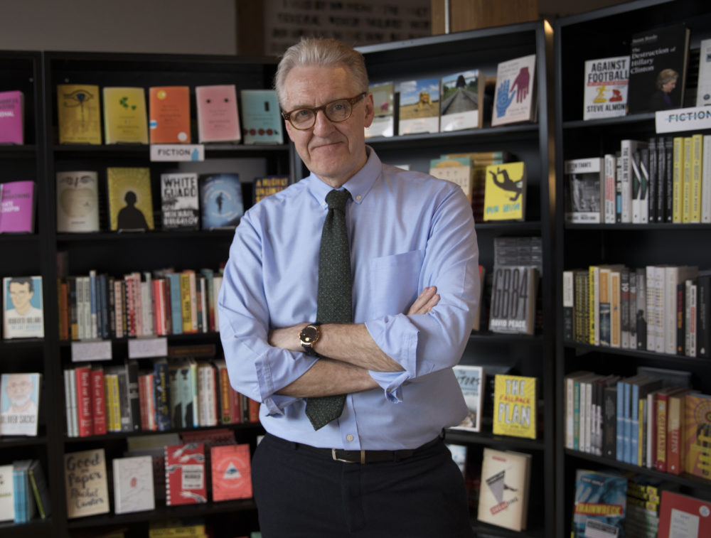 BROOKLYN, NEW YORK - MARCH 28: Dennis Johnson, the co-owner of Melville House, stands in front of a display of his publishing house's titles March 28, 2017 in the DUMBO neighborhood of Brooklyn, New York. Johnson founded the Melville House publishing company with sculptor Valerie Merians in 2001 and located their offices and store to Brooklyn in 2008. (Photo by Robert Nickelsberg)